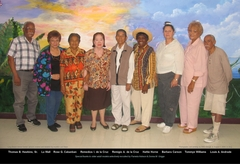 older adult volunteers in front of tropical mural at Long Beach Senior Center